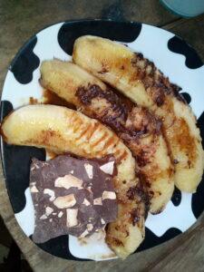 fried bananas with chocolate sauce
